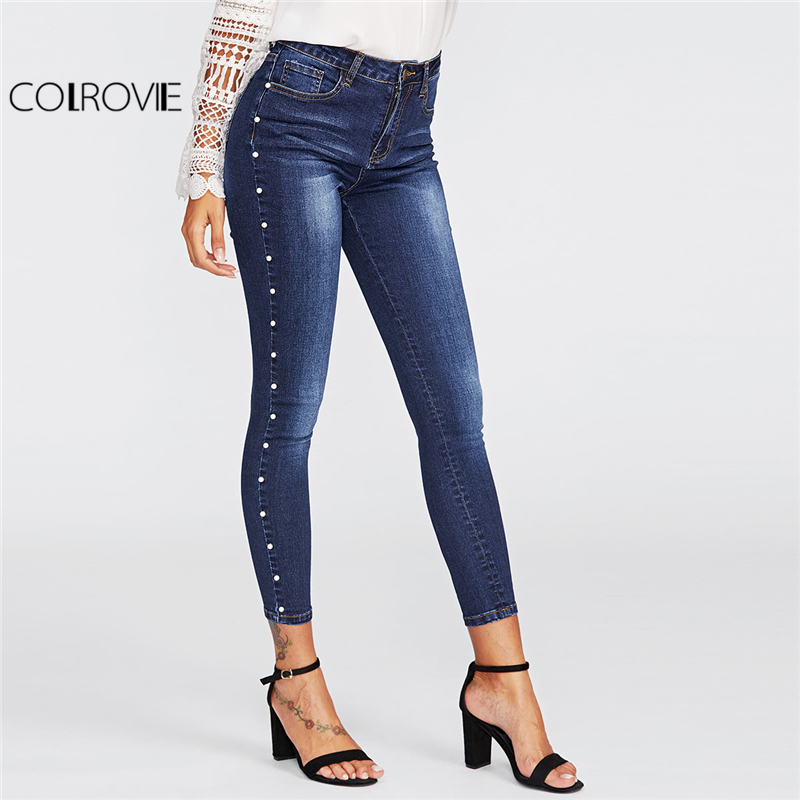 Pantalon jean avec rivet en mode slim