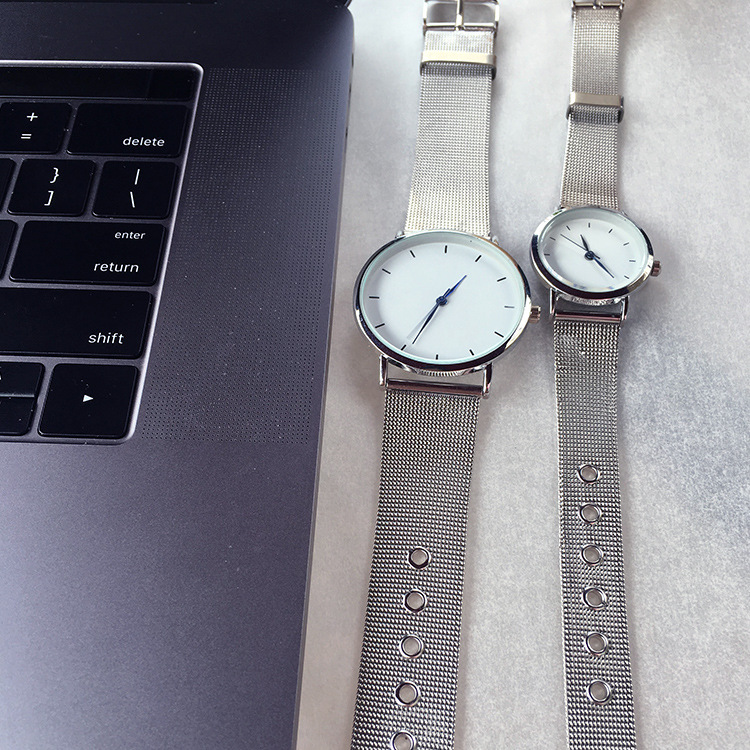 1489d8657 Aliexpress.com : Buy Hot fashion minimalism style women's watches blue  pointer simple silver watch women quartz clock with stainless steel mesh  band from ...