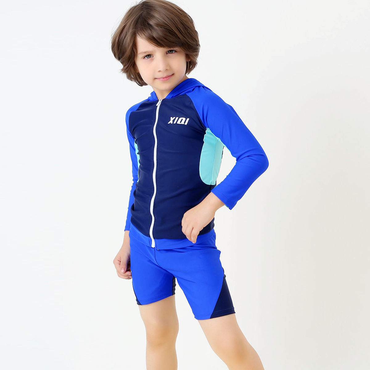 This all in one swimsuit for younger boys is perfect for holiday season or simply for swimming lessons. Featuring sleeves and legs and a cute monkey print.