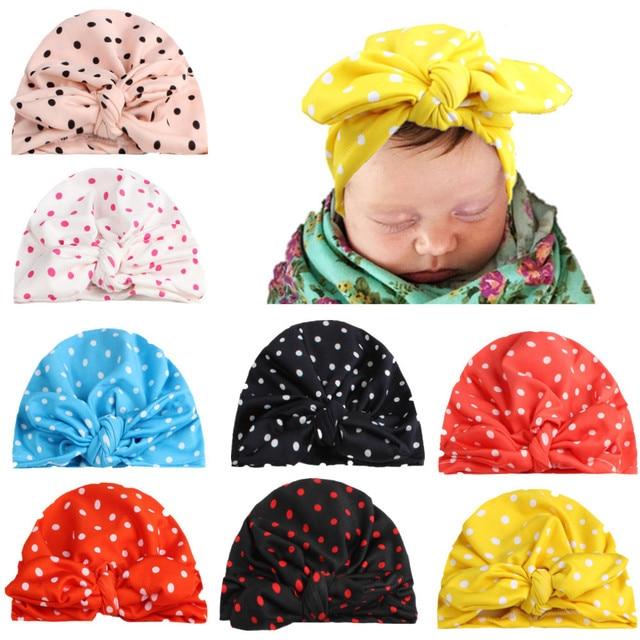 Niño bebés que hacen punto lunares sombrero oreja de conejo arcos ...