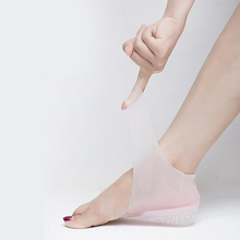 Unisexความสูงที่มองไม่เห็นเพิ่มถุงเท้าHeel Pads Insolesซิลิโคนนวดเท้าปรับสวมใส่Insoles 2/3/4ซม.คู่