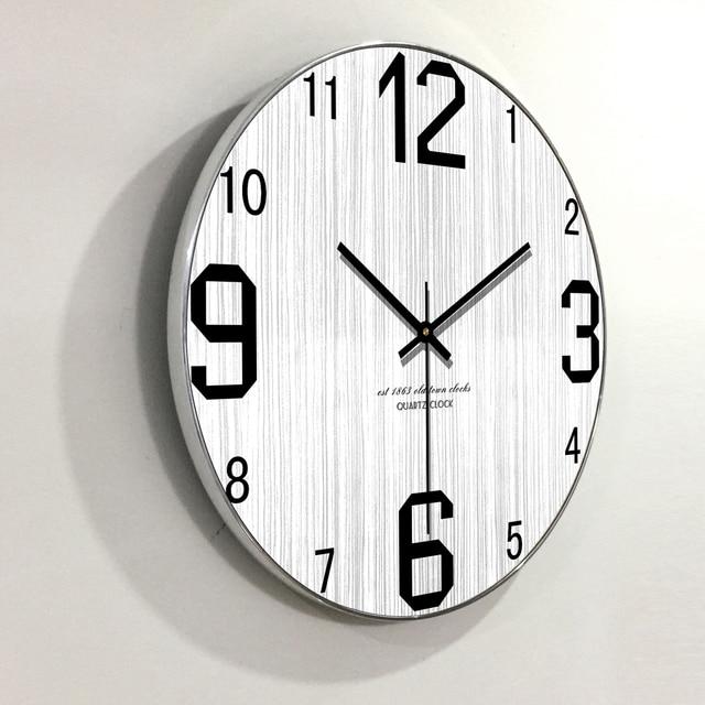 7a418cc88f4 Horloge murale en bois Design moderne personnalité créative nordique Style  Grain de bois horloges suspendues montre