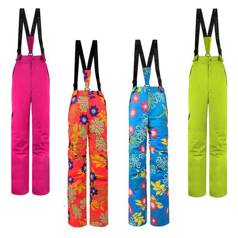 Marque femmes pantalon de Ski avec bretelles chaud imperméable coupe-vent Snowboard pantalon extérieur neige pantalon