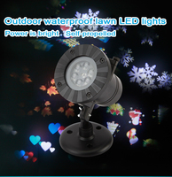 12 Petterns Waterproof Moving Snow Laser Projector Lamp Snowflake LED New Year Party Christmas Lights Outdoor