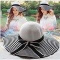 Мода соломы шапки вс лето широкими полями пляж hat с бантом флоппи складная черный и белый полосатый для дам