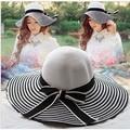 Tapas de paja de moda dom sombrero de ala ancha playa del verano con bowknot plegable flojo de rayas blanco y negro para las señoras