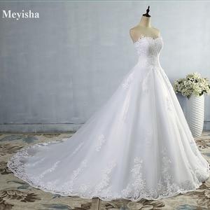 Image 1 - ZJ9059 2019 2020 Weiß Elfenbein Kleid Tüll Schatz Hochzeit Kleid Real Photo Gericht Zug für braut Kleider plus größe Hohe qualität