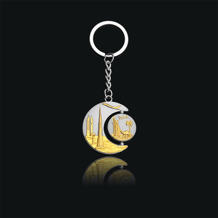 The landmark buildings in Dubai are placed in the shape of the moon and the sun Key buckle