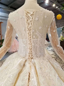 Image 4 - LSS156 see through wedding dress illusion o neck long sleeves lace up back beauty vestidos de novia baratos con envio gratis