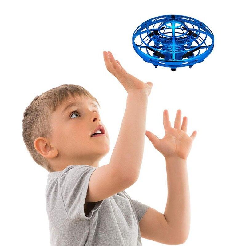 Pelota de OVNI avión volador Anti-colisión OVNI de mano helicóptero mini drone pequeño inteligente inducción quadcopter Drones para niños