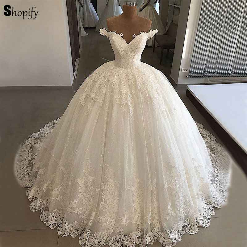 Luxury Bridal Wedding Gowns 2018 Puffy Ball Gown V-neck Cap Sleeve Lace  Bling Bling 30b7092e4ee6