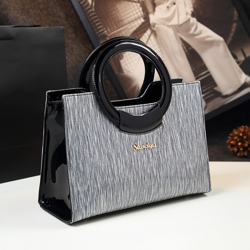 2019 new designer high quality luxury patent leather women hand bag top handle shoulder striped pattern handbags famous brands2019 new designer high quality luxury patent leather women hand bag top handle shoulder striped pattern handbags famous brands