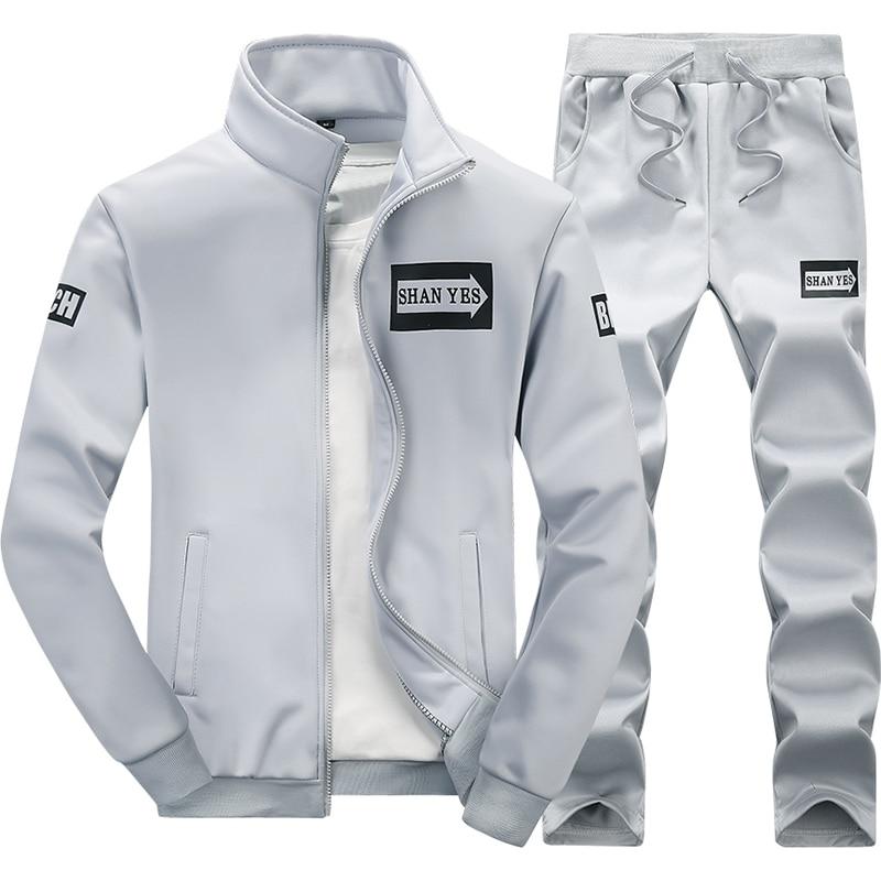 Ensemble de Sport hommes coupe-vent Fitness Sportsuit Polyester tricot Sportswear 2018 nouveau chaud Sweat costume Gym Sport costume ensembles de course
