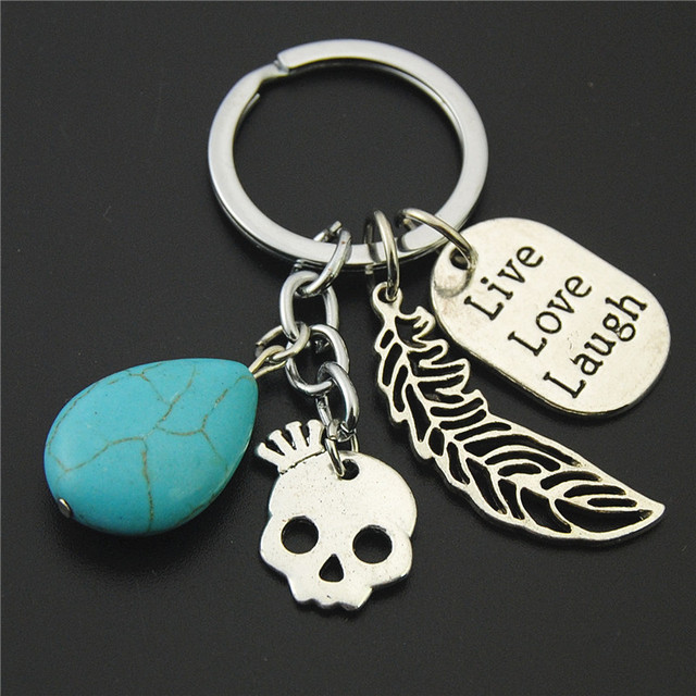 1pc blue bead skeleton feathers key chains words live love laugh 1pc blue bead skeleton feathers key chains words live love laugh pendant diy handmade for gift aloadofball Gallery
