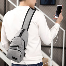 купить 2019 new portable USB smart chest bag Messenger bag casual fashion shoulder bags ant cloth Korean casual canvas men bags по цене 703.42 рублей