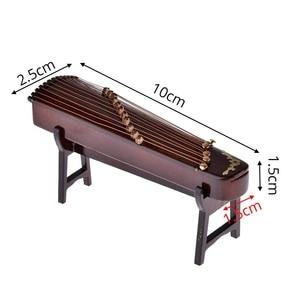 Image 4 - Mini instrumento Musical de madera caliente hecho a mano miniatura Guzheng modelo ornamentos regalos conmemorativos 10cm