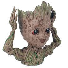 6e4661f06bf7 Bebé Groot maceta jardinera de figuras de acción de guardianes de la galaxia  árbol de juguete hombre lindo modelo juguete pluma .