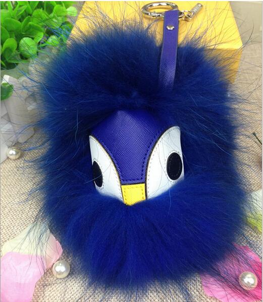 Envío de la nueva Piel Real de Cuero Monster Pom Pom Azul bolso colgante correa de piel de mapache Muñeca Bola llavero de coches Encanto accesorios