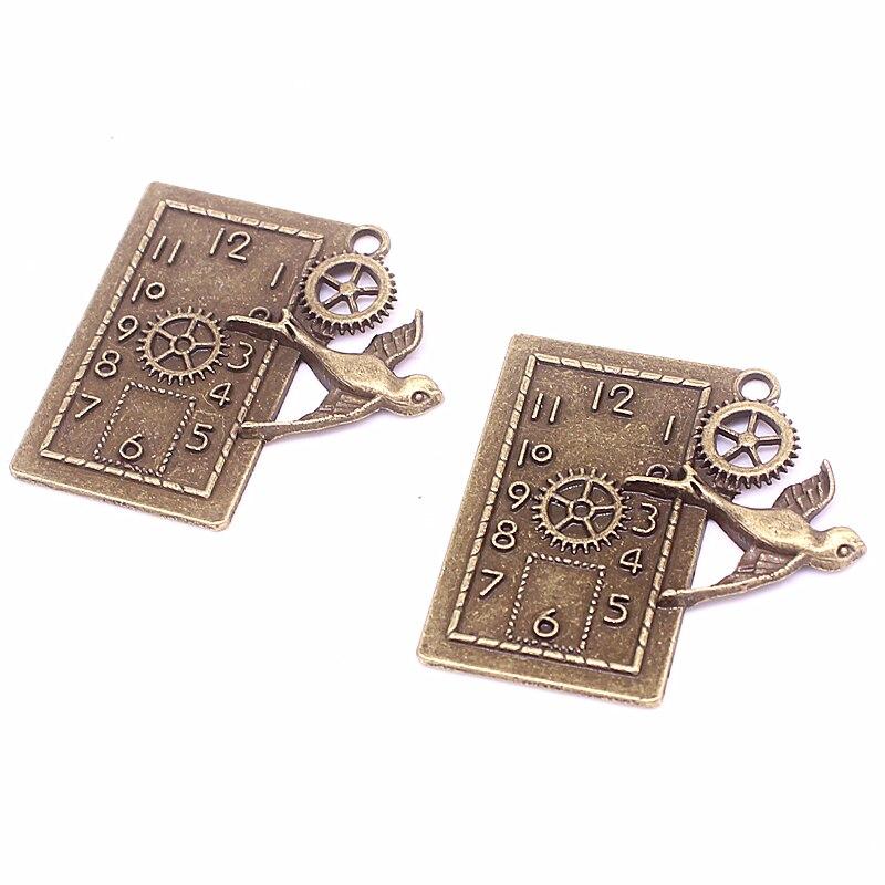 d944a690ade9 Sweet Bell 10 unids 39 39mm bronce antiguo Gear reloj birdie Amuletos  Colgantes fit collar de las pulseras DIY metal joyería d6013