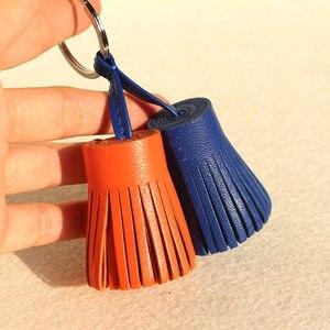 Image 2 - Llavero para las llaves del coche con borla de cuero genuino, llavero de lujo de marca famosa, bolso de mujer, colgante de mochila