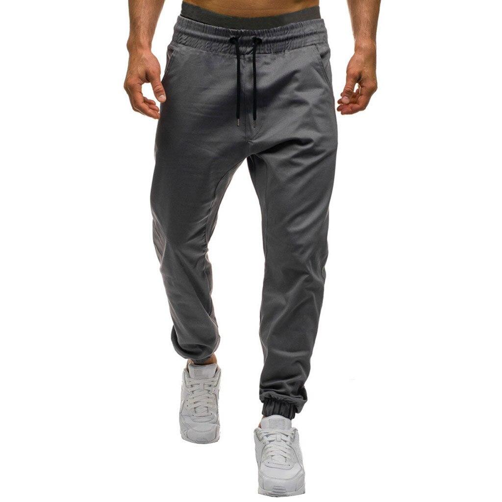 Men Loose Sweatpants Plus Size Joggers Fitness Tracksuit Pocket Sport Pants Drawstring Male Workout Trousers Training Sportswear