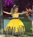 2017 Meninas Vestidos Pageant vestido de Baile Cap Mangas de Cetim Apliques Amarelo Tutu Little Baby Vestidos Da Menina de Flor Para Casamentos