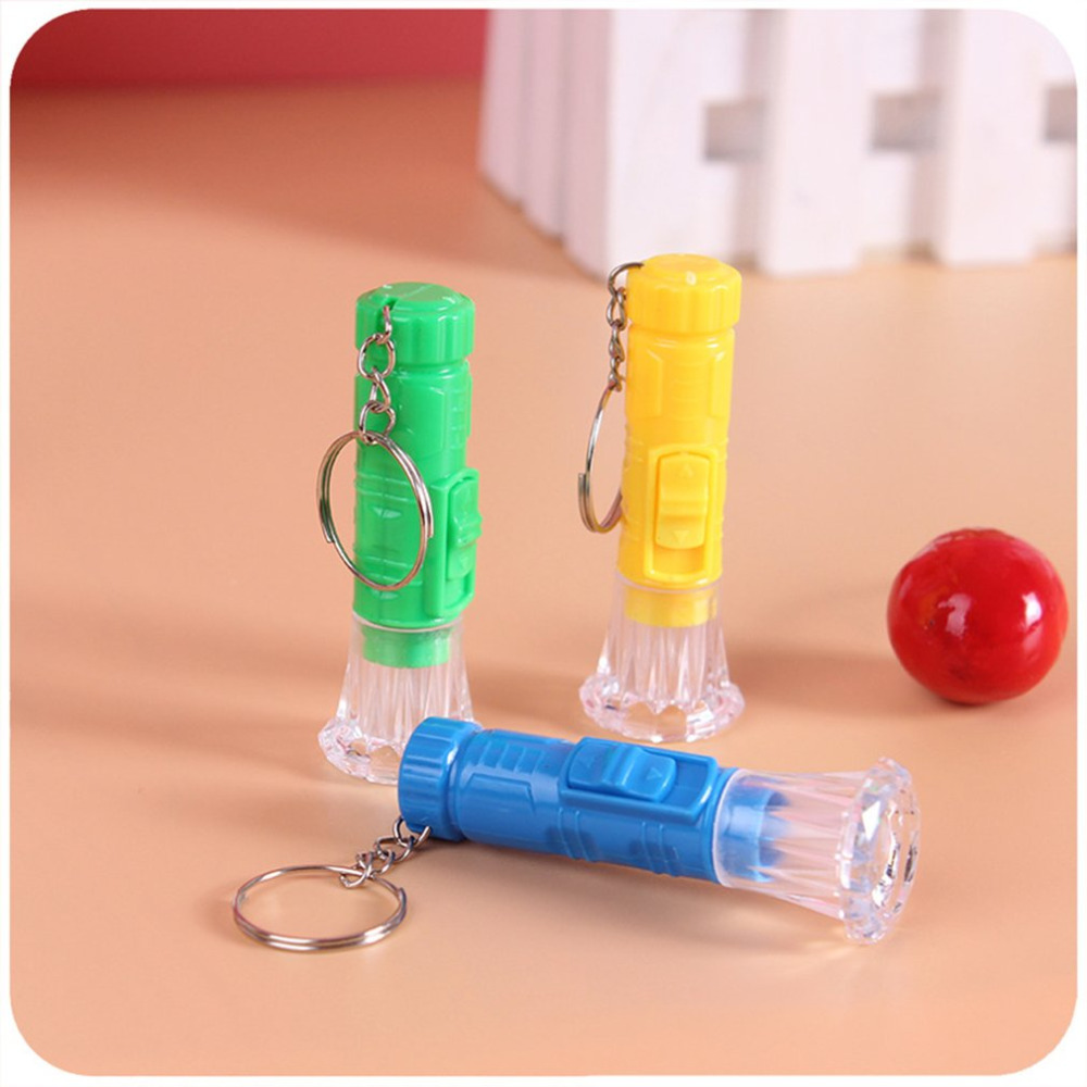 1PC Mini Plastic Hand Torch Portable Keyring Super Bright LED Flashlight Button Cell Powered Flash Light (Random Color)