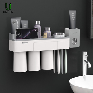 Image 2 - UNITOR Plastic Wall Mounted Toothbrush Holder Automatic Toothpaste Dispenser Toiletries Storage Rack Bathroom Accessories Set