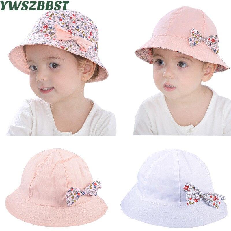 86222cc667a1a Verano bebé sombrero de sol Flor del Bowknot del sombrero del bebé del  algodón de la impresión niños niño sombrero del cubo del casquillo doble  cara puede ...
