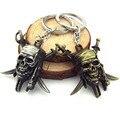 Piratas of the caribe llavero capitán Jack Sparrow máscara cráneo y las tibias cruzadas anillo para los aficionados