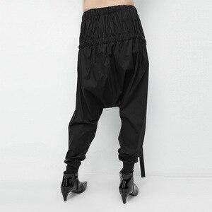 Image 4 - [Eam] 2020 primavera preto solto cintura elástica rendas até emendado personalidade casual harem calças moda nova feminina la982