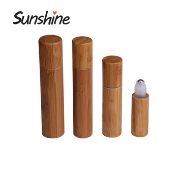 50pcs *15ml Unique special design natural bamboo packaging roll on glass bottle stainless steel metal ball bamboo perfume roller