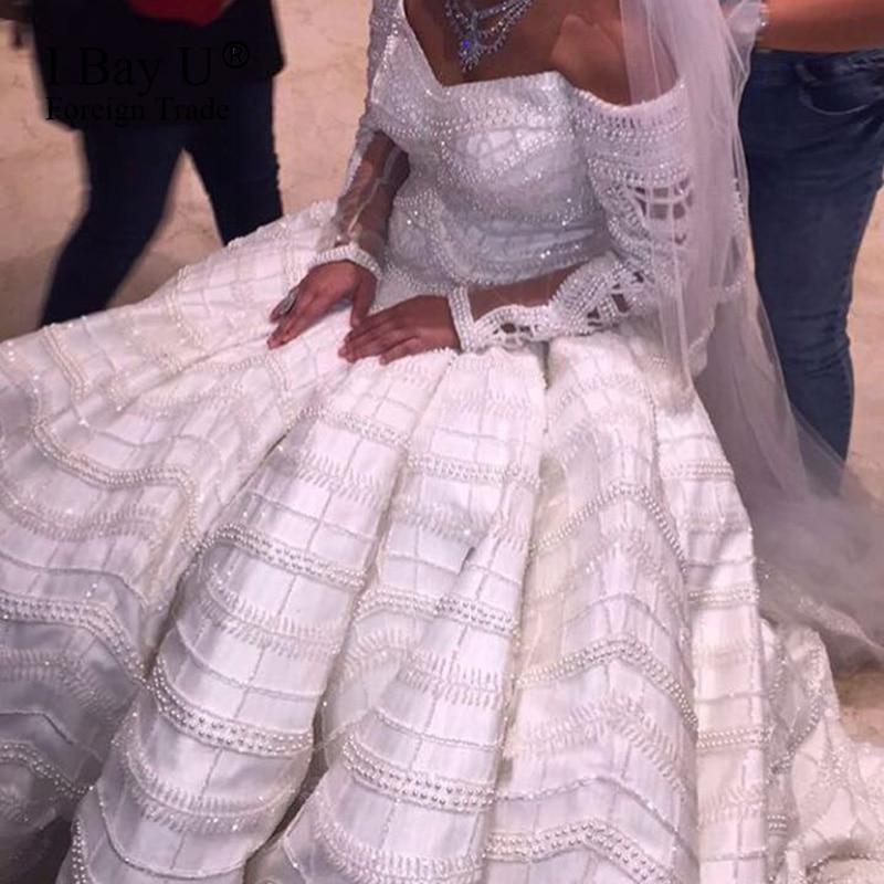 Vestido De Noiva Princesa Luxo Pearl Arab Wedding Dresses 2017 Spring Off  Shoulder Big Ball Gown Wedding Dress Robe De Mariee-in Wedding Dresses from  ... a045ba3d4