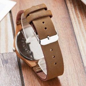 Image 4 - Moda imitacja drewniany zegarek kobiety miękki skórzany pasek moda montre femme unikalny projekt łosia analogowy zegarek kwarcowy relogio