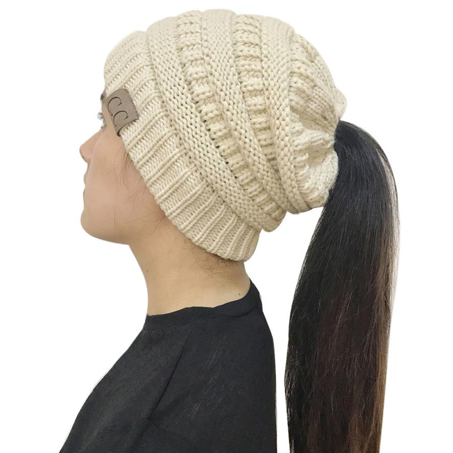 CC Ponytail Beanie Hat Autumn Winter Outdoor Warm Hat Crochet Knit Holey  Beanie Cap Female Knitted Skullies Beanies Ponytail hat 67bc89fb4e8