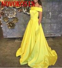 Элегантное вечернее платье с открытыми плечами длинное желтое