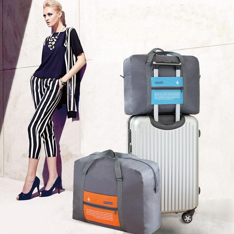 купить Fashion Travel Bag WaterProof Travel Folding Bag Large Capacity Unisex Luggage Packing Women Nylon Travel Handbags Free Shipping онлайн