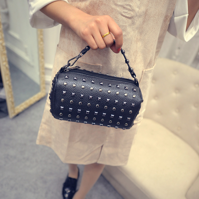 The new 2016 mini summer s Boston small bag handbag rivet portable oblique satchel female han edition of the pillow pack woman in the summer of 2016 youth popular color patent leather crocodile pillow boston crossbody bag business mini pochette