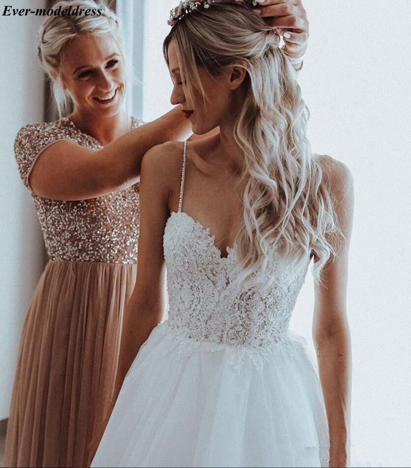 2019-spaghetti-straps-beaded-pearls-tulle-boho-wedding-dresses-sleeveless-sweep-train-beach-bridal-gowns-appliques-wedding-gowns-for-brides (1)_conew1