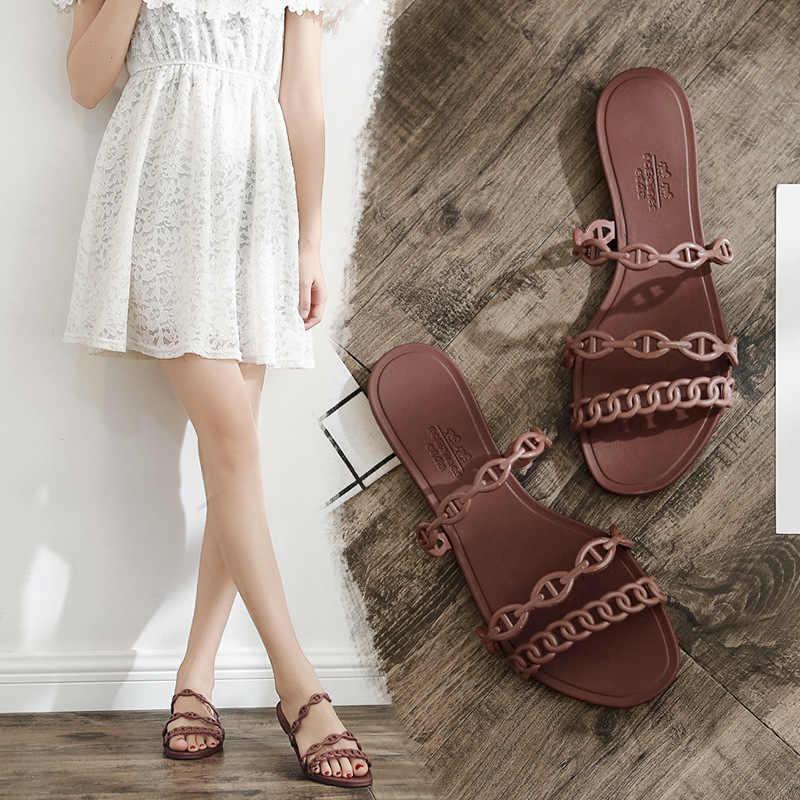 Explosion female summer fashion wear Korean version of the outdoor student flat bottom three belt beach word sandaling.