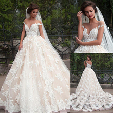 Fantástico vestido de novia de tul con escote de murciélago, vestidos de novia con apliques de encaje champán