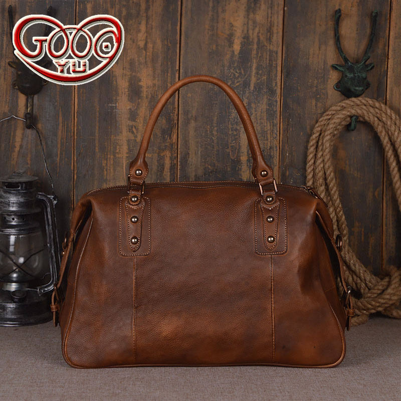 Stylish new imported first layer tanned leather travel bag hand-color unisex cross section hand-held large-capacity travel bag europe and the united states fashion new imported first layer tanned leather hand luggage bag hand color shoulder diagonal compu