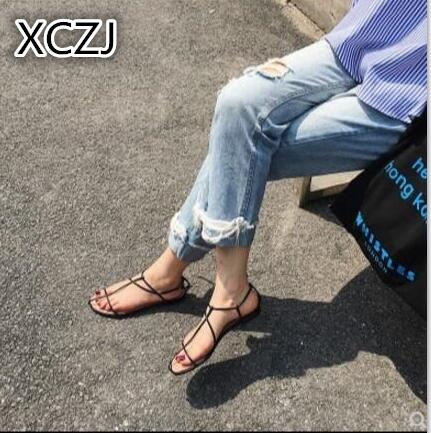 XCZJ 2018 summer Korean version of the new comfortable word with a flat low-heeled strap sandals women's side empty shoes xczj sandals female 2018 summer new thick with bow tie lattice shoes korean students wild word buckle high heels