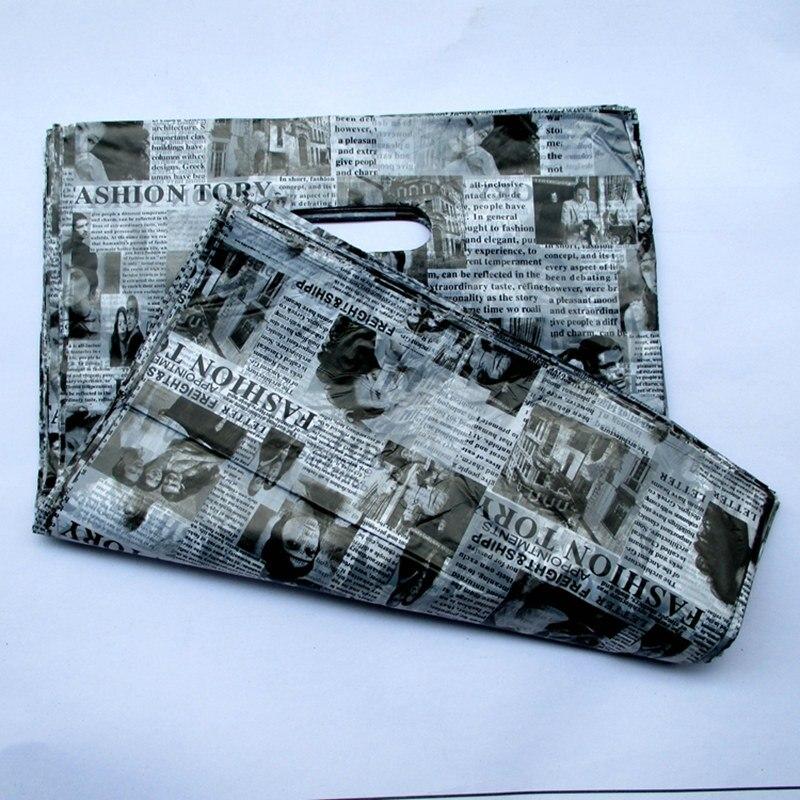 100 pcs/ensemble 50*40 cm De Nombreux gros journal Anglais motif sac cadeau en gros de sacs en plastique 94021