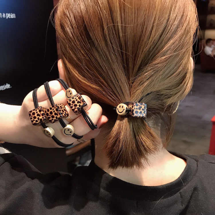 Brand new high quality women's clothing seven color elastic tape black hair rope ponytail girl hair ornament lace up gum