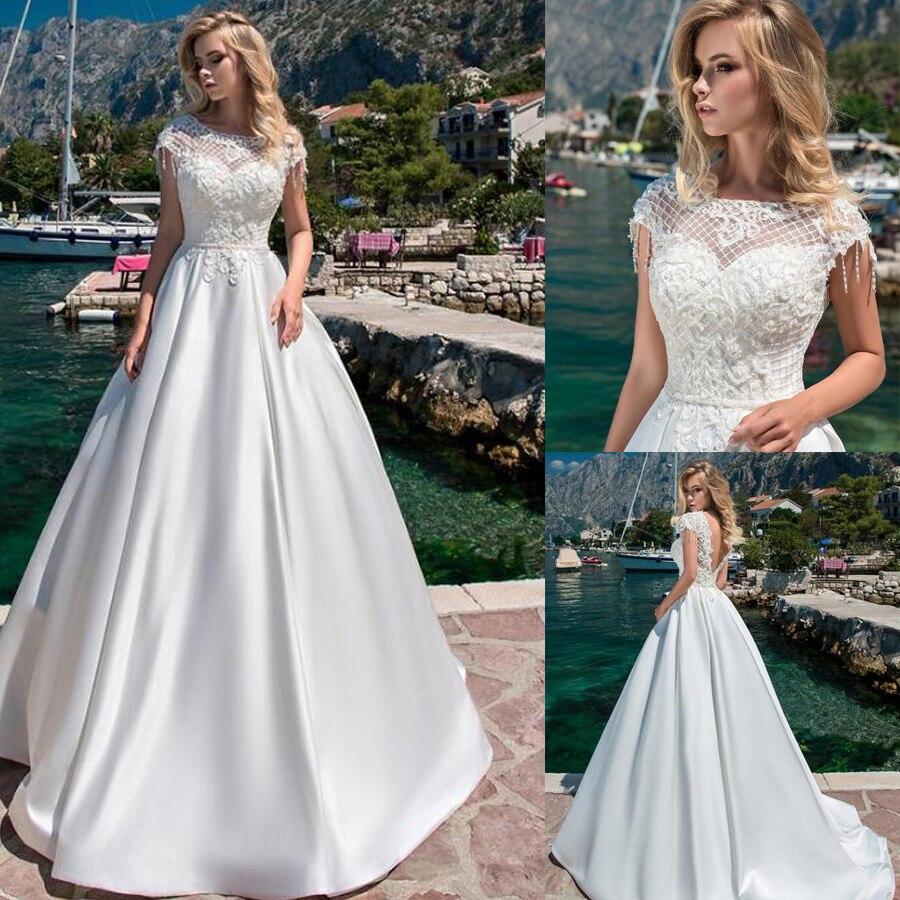 Junoesque Satin O-neck A-line Wedding Dresses With Beaded Lace Appliques Backless Sweep Train Bridal Dress Vestido De Novia