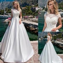 Junoesque Satin O neck A line Wedding Dresses with Beaded Lace Appliques Backless Sweep Train Bridal Dress vestido de novia