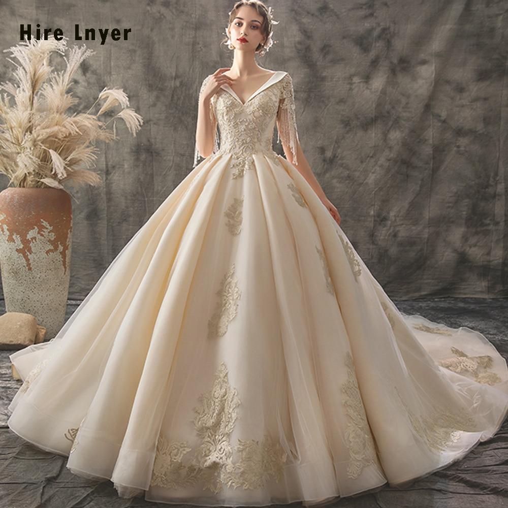 Vestido De Noiva Princesa 2020 Custom Made V-neck Lace Up Beading Sequins Gold Appliques Ball Gown Wedding Dress Bruidsjurk