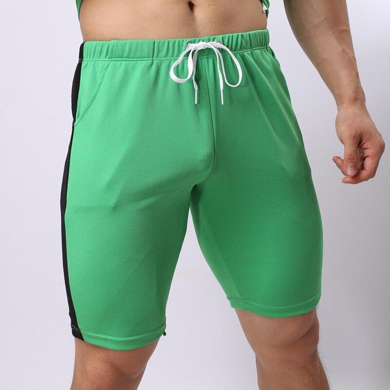 Verão lazer Esportivos gay men shorts calças elásticas dos homens da marca  academias shorts mens moda calças desgaste exterior calças de secagem  rápida em ... 3fa61cb7bbd33