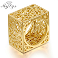 Mytys Yellow Gold Plated Hollow 3D Square Ring For Women Geometric Flower Pattern Hollow Unique Design Ring R1134